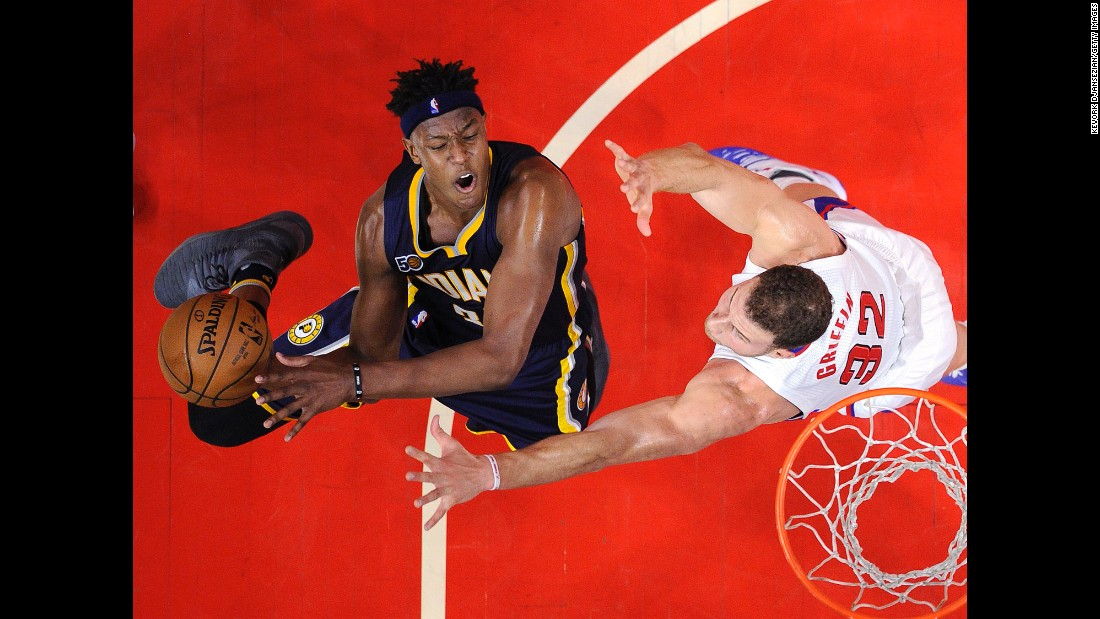 Indiana's Myles Turner, left, goes for a layup against Los Angeles' Blake Griffin in the second half of an NBA game in Los Angeles on Sunday, December 4. Indiana defeated Los Angeles 111-102.