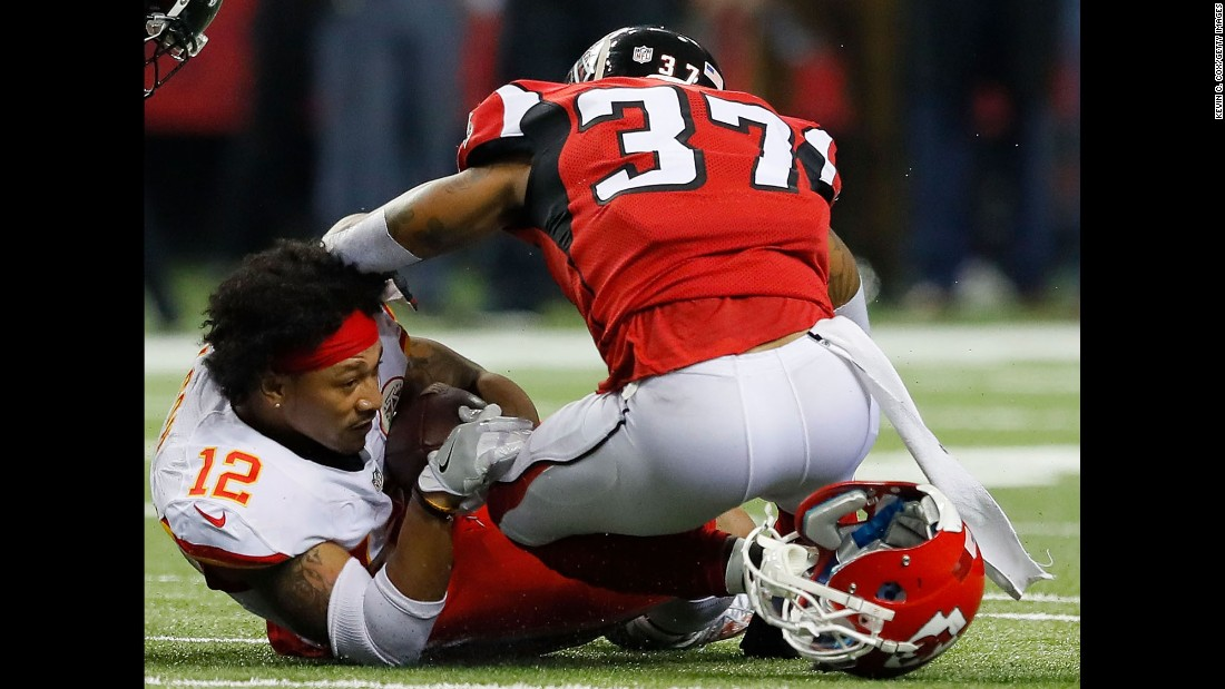 Kansas City's Albert Wilson, left, is tackled by Atlanta's Ricardo Allen after Wilson converted a first down during a game in Atlanta on Sunday, December 4. Wilson sealed his team's 29-28 victory over Atlanta.
