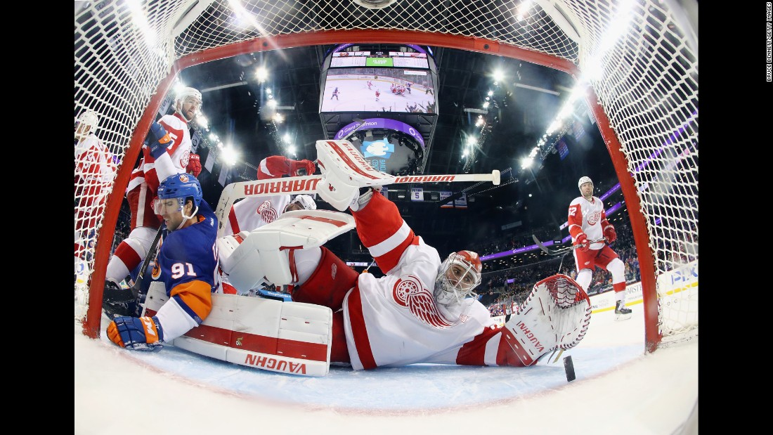 Detroit's Petr Mrazek watches as a shot by New York's Josh Bailey goes into the goal during an NHL hockey game in Brooklyn, New York, on Sunday, December 4. Detroit won 4-3 in overtime.