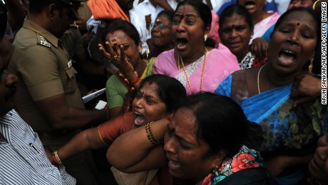 Indian supporters of the Chief Minister of Tamil Nadu Jayalalithaa Jayaram react outside the hospital where she was being treated in Chennai on December 5, 2016.