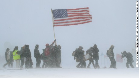 Military veterans march in support of protesters at the Standing Rock Sioux reservation on December 5.