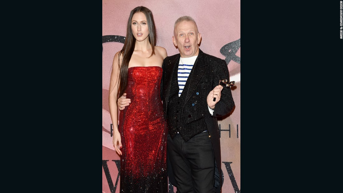 Jean Paul Gaultier walks the red carpet with model Anna Cleveland.