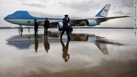 Air Force One, with President Barack Obama aboard, is reflected in the wet tarmac on arrival at Andrews Air Force Base, Md. Wednesday, July 29, 2009. (AP Photo/Pablo Martinez Monsivais)