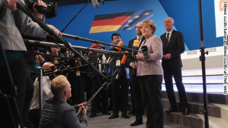 German Chancellor Angela Merkel delivers her opening statement at her party's annual federal congress on Monday in Essen.