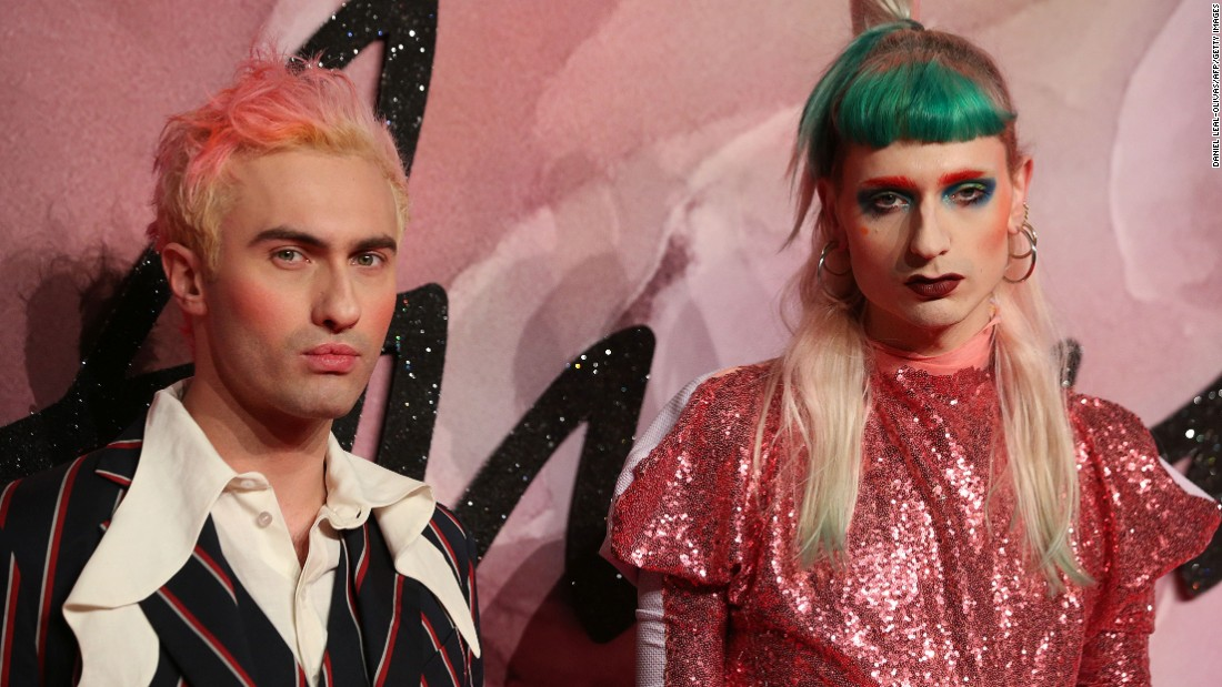 Scottish-born fashion designer Charles Jeffrey poses on the red carpet with Matty Bovan.