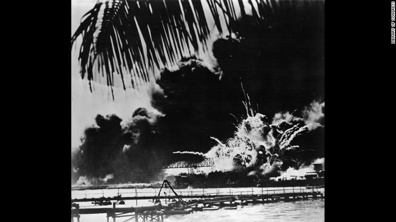 Smoke and flames rise from the USS Shaw in Pearl Harbor after the Japanese attack on December 7, 1941. The Japanese Imperial Navy launched the surprise strike on the US naval base at the harbor, located on the Hawaiian island of Oahu. The assault killed more than 2,000 Americans and destroyed a significant number of US battleships and airplanes.