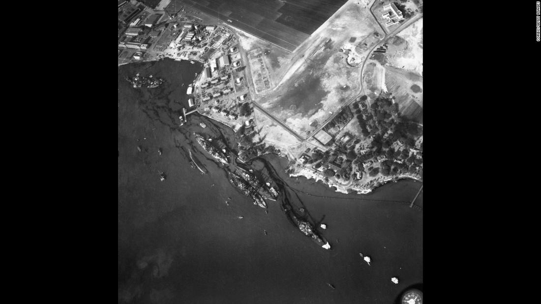 An aerial view of the harbor shows the destruction of the USS California, the USS. Maryland, the USS Oklahoma, the USS Tennessee, the USS West Virginia and the USS Arizona.
