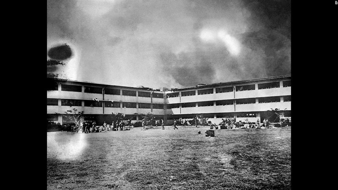 A fire spreads through the Army barracks at Hickam Field.