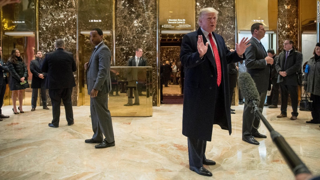 Trump speaks to members of the media in the lobby at Trump Tower in New York on December 6.