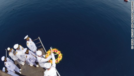 JAVA SEA (Oct. 14, 2014 ) Sailors assigned to the submarine tender USS Frank Cable (AS 40) lower a wreath into the water as naval officers from Australia, Indonesia and the United States observe during a ceremony in honor of the crews of the U.S. Navy heavy cruiser USS Houston (CA 30) and the Royal Australian Navy light cruiser HMAS Perth (D29). Both ships were sunk during World War II by Imperial Japanese forces within Indonesian waters during the battle of Sunda Strait in February 1942.  Frank Cable, forward deployed to the island of Guam, conducts maintenance and support of submarines and surface vessels deployed to the U.S. 7th Fleet areas of responsibility and is on a scheduled underway. (U.S. Navy photo by Mass Communication Specialist 3rd Class Gabrielle Joyner/Released)