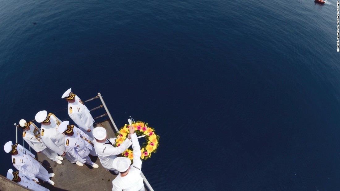 US sailors lower a wreath in the area the ships sank on the 73rd anniversary of the Battle of the Sunda Strait.