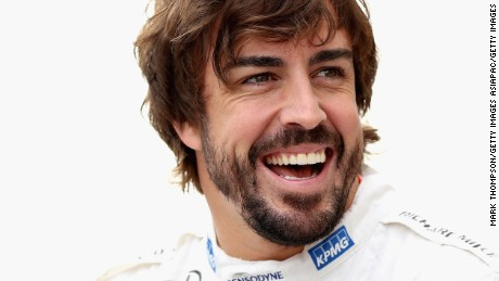 SUZUKA, JAPAN - OCTOBER 07:  Fernando Alonso of Spain and McLaren Honda laughs at the McLaren Honda team photo during practice for the Formula One Grand Prix of Japan at Suzuka Circuit on October 7, 2016 in Suzuka.  (Photo by Mark Thompson/Getty Images)