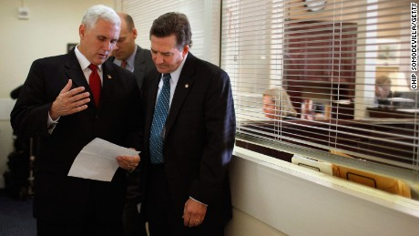 Rep. Mike Pence (left) and Sen. Jim DeMintdiscuss what they are going to say before a news conference at the Capitol on December 2, 2010.