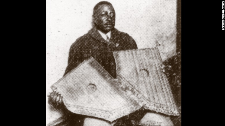 Phillips holding two fretless zithers which he apparently played on his records
