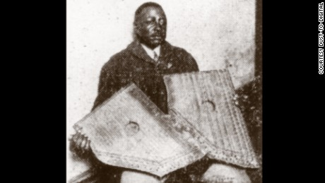 Phillips holding two fretless zithers, which he apparently played on his records.