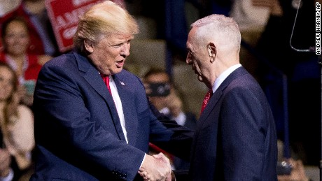 President-elect Donald Trump greets retired Marine Corps Gen. James Mattis, right, as he announces him as his Defense Secretary at a rally at the Crown Coliseum in Fayetteville, N.C., Tuesday, Dec. 6, 2016. (AP Photo/Andrew Harnik)