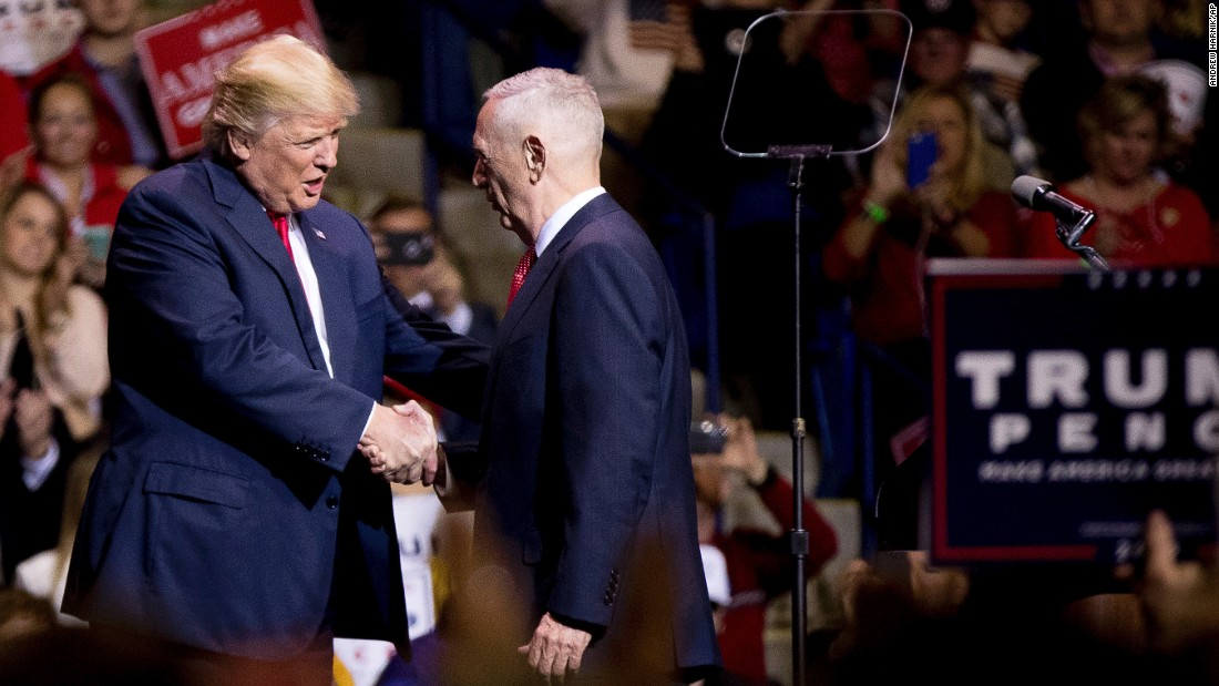 President-elect Donald Trump greets retired Marine Corps Gen. James Mattis, right, at a rally in Fayetteville, North Carolina, on Tuesday, December 6. Trump says he will nominate Mattis as his defense secretary.