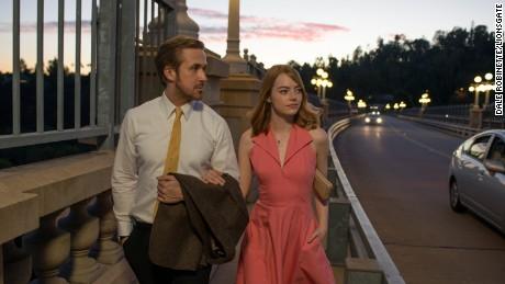 "Sebastian (Ryan Gosling) and Mia (Emma Stone0 take a stroll in ""La La Land"""