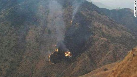 epa05663827 Flames rise from the wreckage of a Pakistan International Airlines (PIA) ATR 42 turboprop passenger plane after it crashed near Abbottabad,Pakistan, 07 December 2016. A  Pakistan International Airlines (PIA) ATR 42 plane with flight number PK-661 with more than 40 people on board has crashed in the north of the country. A spokesperson for the PIA said that an emergency response centre was activated and all resources possible were being mobilised to locate the aircraft. The PIA flight PK-661 was on its way from Chitral to Islamabad.  EPA/STRINGER BEST QUALITY AVAILABLE