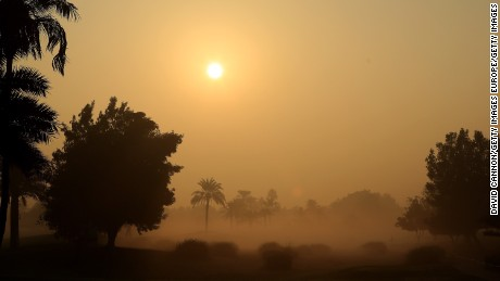 DUBAI, UNITED ARAB EMIRATES - DECEMBER 07:  The sun rises looking down the tenth hole through the ealry morning fog that led to a one delay in play during the first round of the 2016 Omega Dubai Ladies Masters on the Majlis Course at the Emirates Golf Club on December 7, 2016 in Dubai, United Arab Emirates.  (Photo by David Cannon/Getty Images)