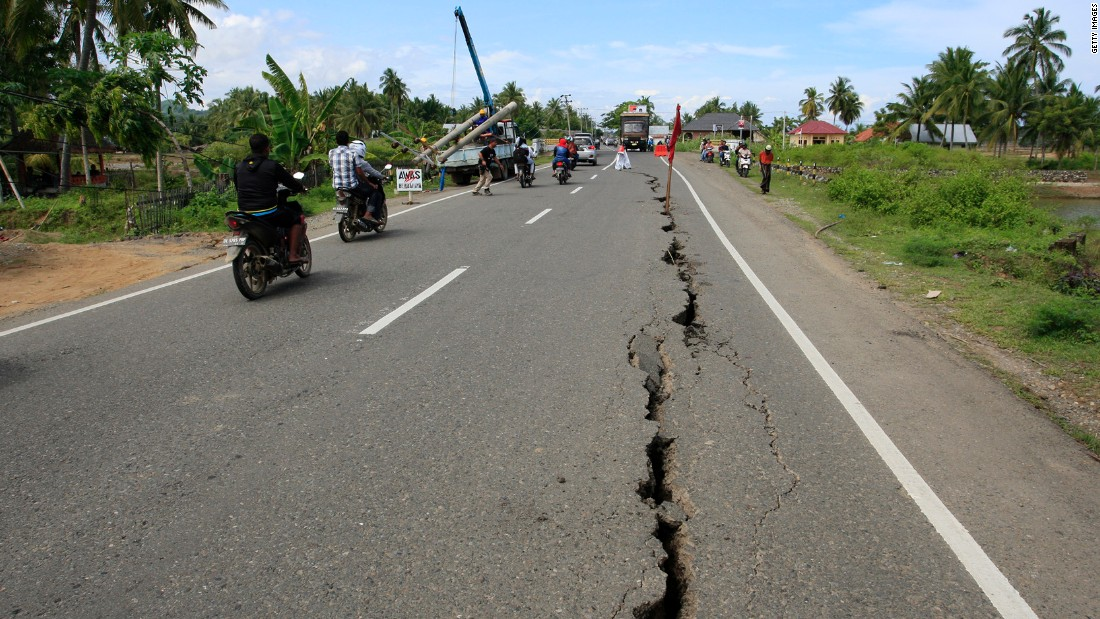 A crack caused by the earthquake is seen along a road in Sigli, Aceh province.