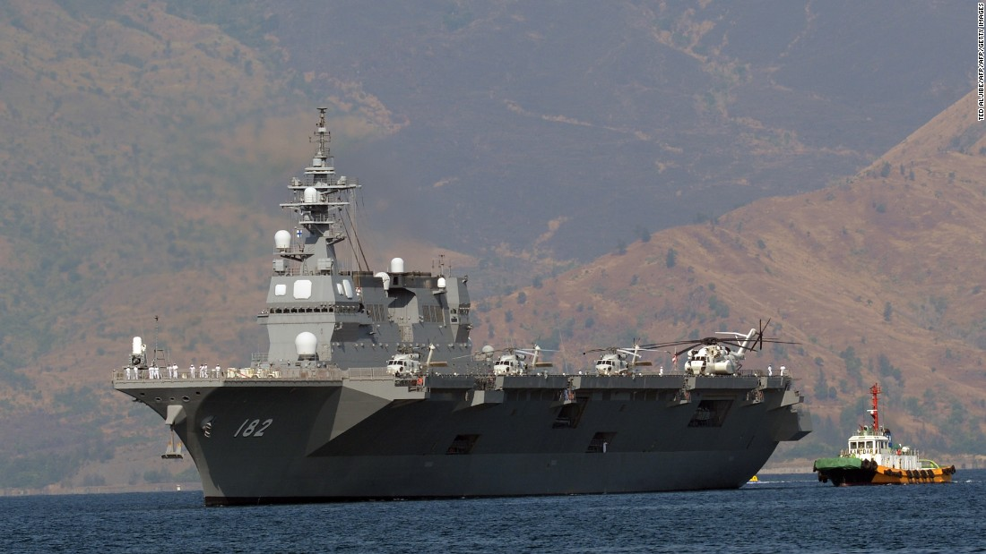Japanese helicopter carrier Ise, one of Japan's biggest warships, is towed as it prepares to dock at the former US naval base at Subic Bay, Philippines, on April 26, 2016.