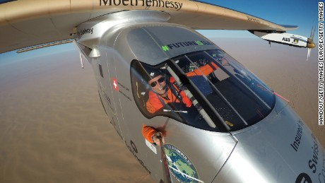 IN FLIGHT  - JULY 25:   In this handout image supplied by Jean Revillard, Swiss pioneer Bertrand Piccard takes a selfie during the last leg of the round the world trip with Solar Impulse 2 over the Arab peninsula prior to the landing in Abu Dhabi to finish the first around the world flight without the use of fuel on July 25, 2016 in Abu Dhabi, UAE. The The 42,000 km journey was completed in 17-stages across four continents. The Solar Impulse 2 is equipped with 17,000 solar cells, has a wingspan of 72 metres, and yet weighs just over 2 tonnes. (Photo by Jean Revillard/Solar Impulse2 via Getty Images)