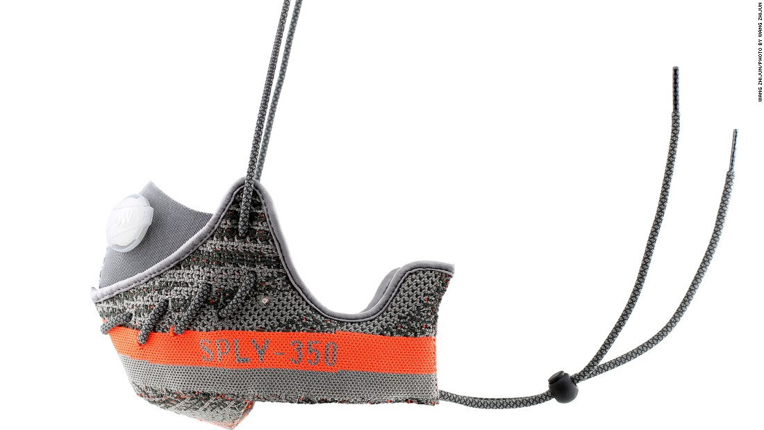 "The Yeezy mask was crafted from two halves of the shoes' orange and gray primeknit uppers. The sneaker's signature ""SPLY 350"" branding is visible on either side."