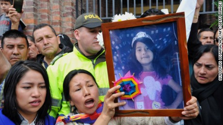 Relatives, friends and police officers leave with the coffin of Yuliana - a seven-year-old girl who was raped, tortured and murdered - after a mass held in her honour at the Santa Teresita church in Bogota, Colombia, on December 7, 2016.  A seven-year-old girl was raped, tortured and murdered in Bogota this weekend, allegedly by a 38-year-old man who kidnapped the girl from her low-income neighborhood on the east side of the city and took her to a luxury apartment belonging to his family, the police said. The girl's body was found on the scene, showing signs of torture and sexual abuse. / AFP / GUILLERMO LEGARIA        (Photo credit should read GUILLERMO LEGARIA/AFP/Getty Images)