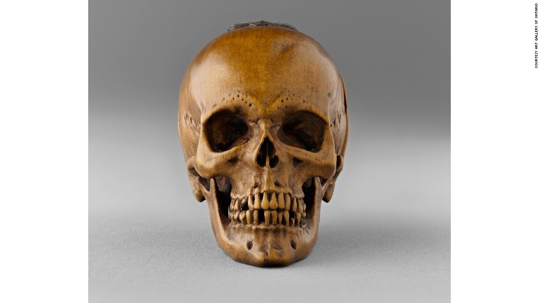 This prayer bead was carved into the shape of a skull.