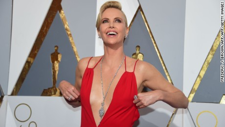 Actress Charlize Theron  arrives  on the red carpet for the 88th Oscars on February 28, 2016 in Hollywood, California. AFP PHOTO / FREDERIC J. BROWN / AFP / FREDERIC J.BROWN        (Photo credit should read FREDERIC J.BROWN/AFP/Getty Images)