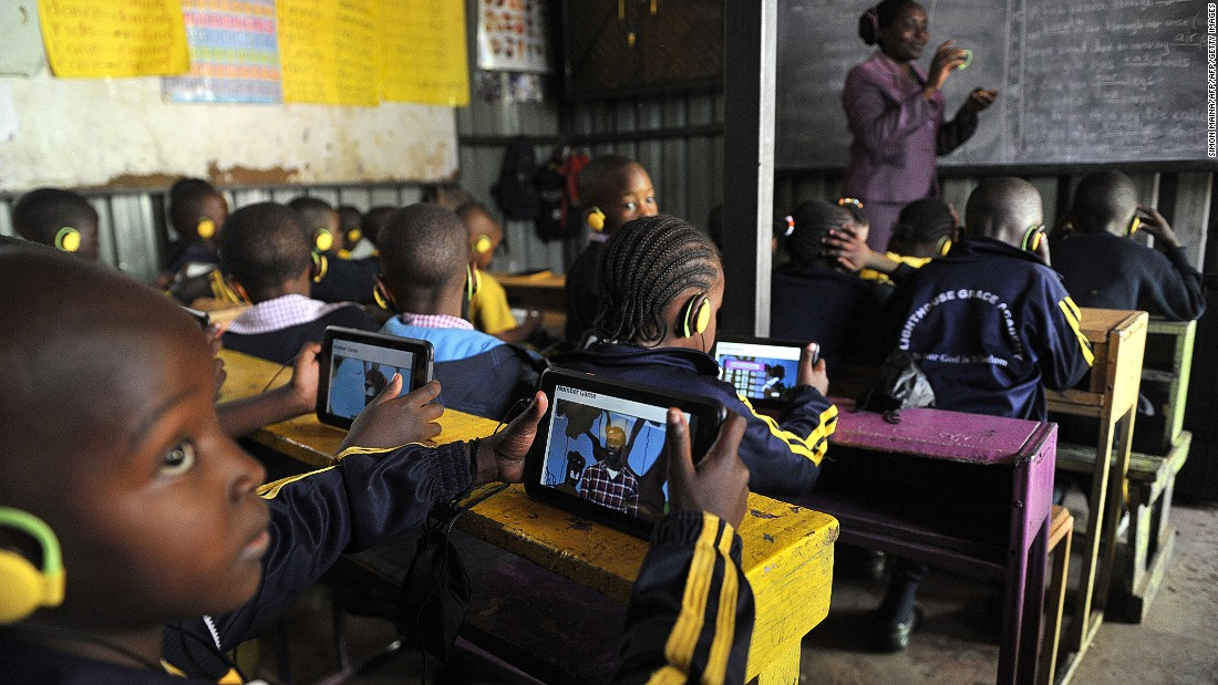 Education is a big priority for Kenyans, with over 80% believing it will be better for the next generation.<br /><br />Pictured here, pupils use the Kio tablet during a class sesssion in Kawangware, Nairobi in October 2015.