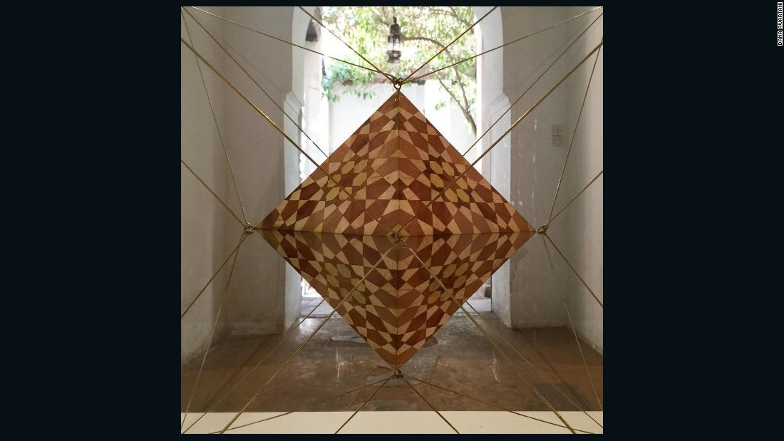 Beyond paintings, the artist aims to explore new forms of geometric art. This complex installation at the Marrakesh Biennale features a dodecahedron within a glass Icosahedron.