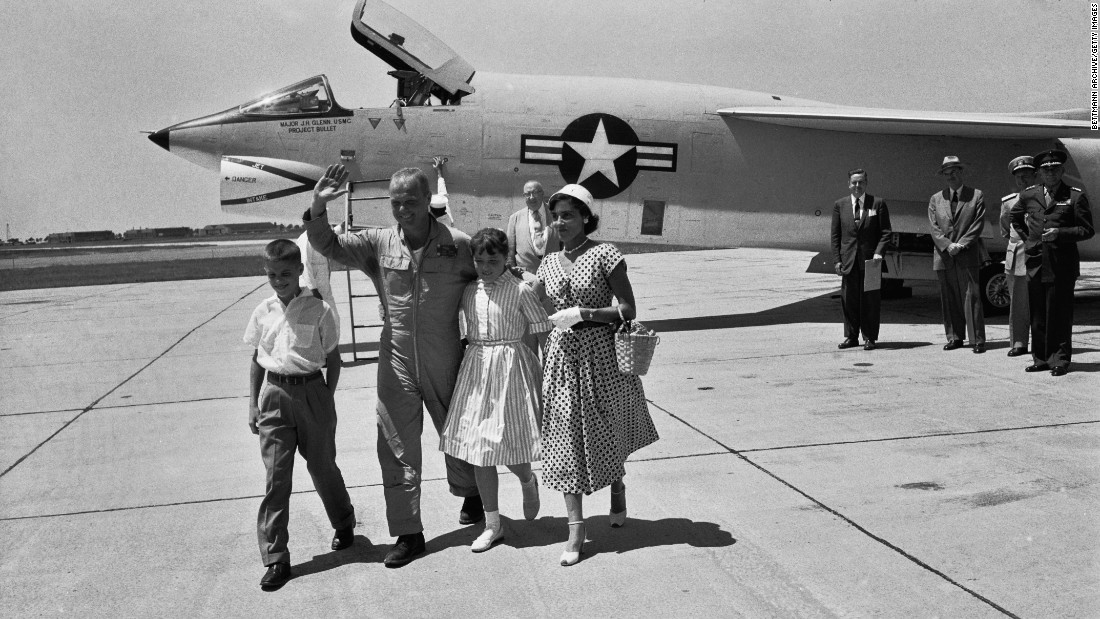 "Glenn's family -- wife  Annie, daughter, Carolyn ""Lyn"" and son David -- greet him at Floyd Bennett Field in New York after his record-breaking transcontinental flight."
