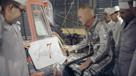 Astronaut John Glenn inspects artwork that will be painted on the outside of his Mercury spacecraft, which he nicknamed Friendship 7. On Feb. 20, 1962, Glenn lifted off into space aboard his Mercury Atlas (MA-6) rocket to become the first American to orbit the Earth. After orbiting the Earth 3 times, Friendship 7 landed in the Atlantic Ocean, just East of Grand Turk Island in the Bahamas. Glenn and his capsule were recovered by the Navy Destroyer Noa, 21 minutes after splashdown.