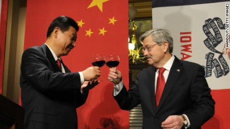 Chinese President Xi Jinping and Iowa Gov. Terry Branstad raise their glasses in a toast at a State Dinner at the state Capitol in February 15, 2012.