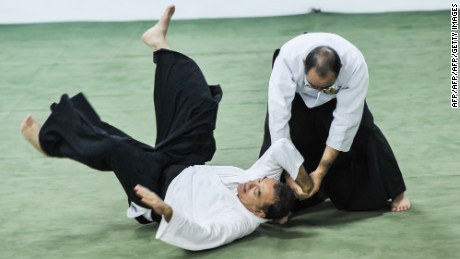 Brazilian aikidokas practice Japanese martial art Aikido in Sao Paulo, Brazil on May 31, 2012. AFP PHOTO/Yasuyoshi Chiba        (Photo credit should read YASUYOSHI CHIBA/AFP/GettyImages)