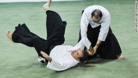 Brazilian aikidokas practice Japanese martial art Aikido in Sao Paulo, Brazil on May 31, 2012. AFP PHOTO/Yasuyoshi Chiba        (Photo credit should read YASUYOSHI CHIBA/AFP/GettyImages)