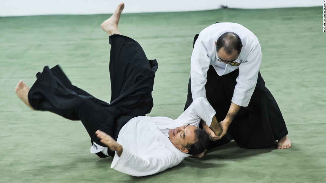 Today, aikido is practiced in dojos all over the world. There are no punches or kicks. It's a form of self-defence that, through locks, holds and throws, uses an opponent's own energy against them.