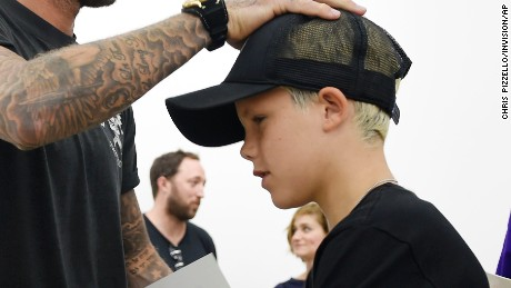 """David Beckham and his son Cruz shop together at Kanye West's """"Pablo"""" pop-up shop on Friday, Aug. 19, 2016, in Los Angeles. The rapper-turned-fashion mogul announced plans to open 21 stores worldwide just for this weekend to sell clothing based on his latest album, """"The Life of Pablo."""" (Photo by Chris Pizzello/Invision/AP)"""