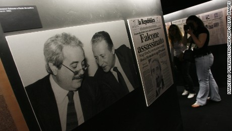 "A photograph of Paolo Borsellino and Giovanni Falcone -- both of who were killed by the mafia -- displayed in the ""Mafia's Museum Leonardo Sciascia"" in Salemi, near Trapani on the Italian island of Sicily on the day of its opening on May 11, 2010."