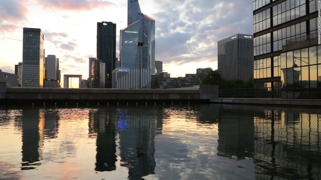 The sunset behind the buildings of La Defense business district in Courbevoie, near Paris.
