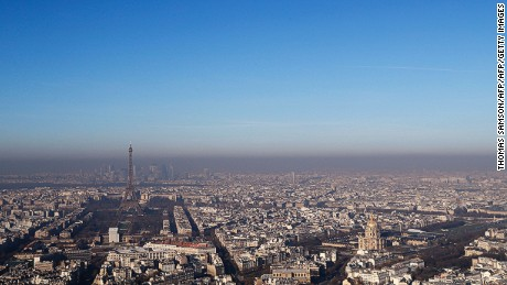 A photo taken from Paris' Montparnasse Tower shows the Eiffel Tower (L) and the Hotel des Invalides (R) in the smog on December 5 2016.