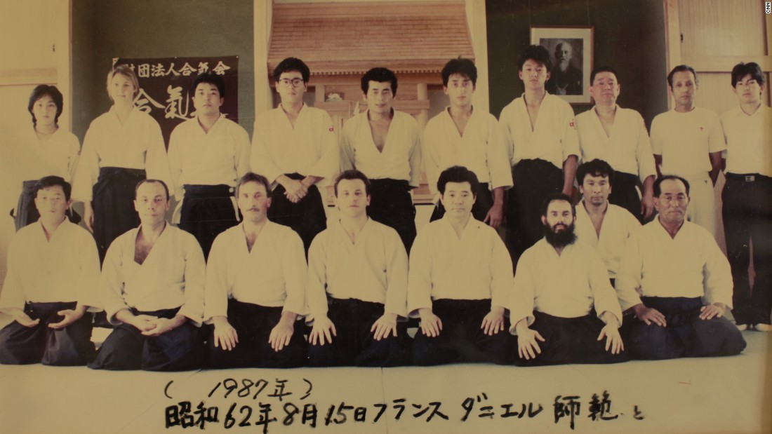 Several photographs hang inside Aikido Tanabe Dojo highlighting visits by foreign aikidokas.