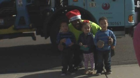 Sanitation worker spreads holiday cheer