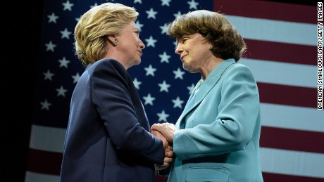 Democratic presidential nominee Hillary Clinton (L) and Senator Dianne Feinstein (D-CA) embrace during a fundraiser at the Civic Center Auditorium October 13, 2016 in San Francisco, California.