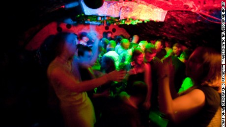 Group of people dance at an underground disco