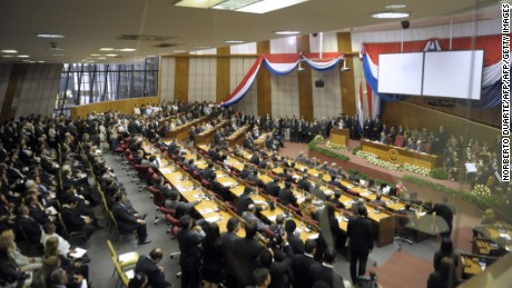 View of Paraguay's Congress while President Federico Franco, who took office on June 22 following the impeachment and dismissal of former president Fernando Lugo, speaks for the first time as president in Asuncion on July 1, 2012. Lugo's abrupt ouster a week ago on charges of malfeasance linked to a deadly land dispute has been widely criticized by other Latin American leaders, who say the president did not have time to mount a proper defense. Elections in Paraguay are expected in April 2013.  AFP PHOTO/NORBERTO DUARTE        (Photo credit should read NORBERTO DUARTE/AFP/GettyImages)