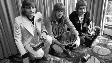 "1972 photo shows Greg Lake (left), Keith Emerson (center) and Carl Palmer of progressive rock group Emerson, Lake & Palmer. Lake's manager says the musician died December 7 after a ""long and stubborn battle with cancer."""