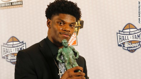 Louisville quarterback Lamar Jackson holds the Maxwell Award after being named the College Football Player of the Year Thursday, Dec. 8, 2016, in Atlanta. (AP Photo/John Bazemore)